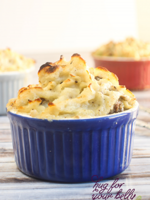 blue dish with shepherds pie, showing crispy potatoes