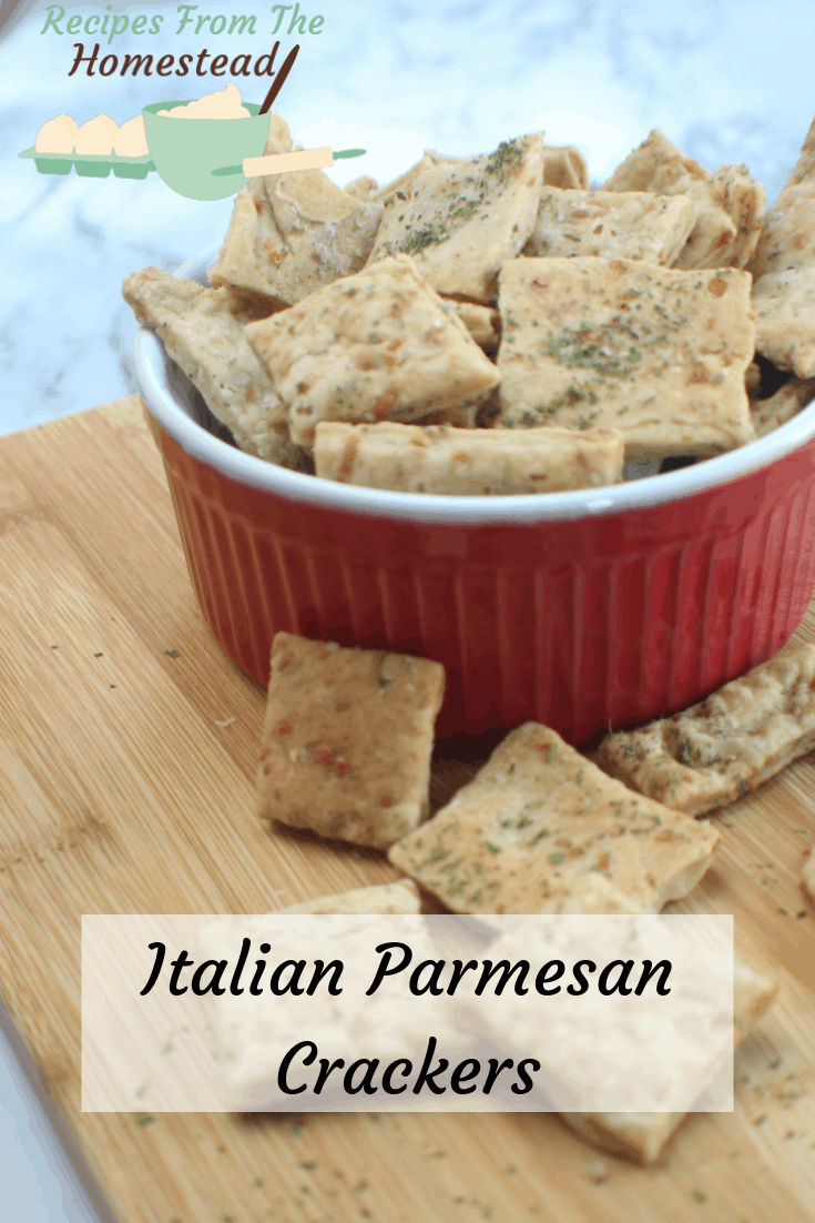 homemade parmesan crackers on wooden board and in red bowl