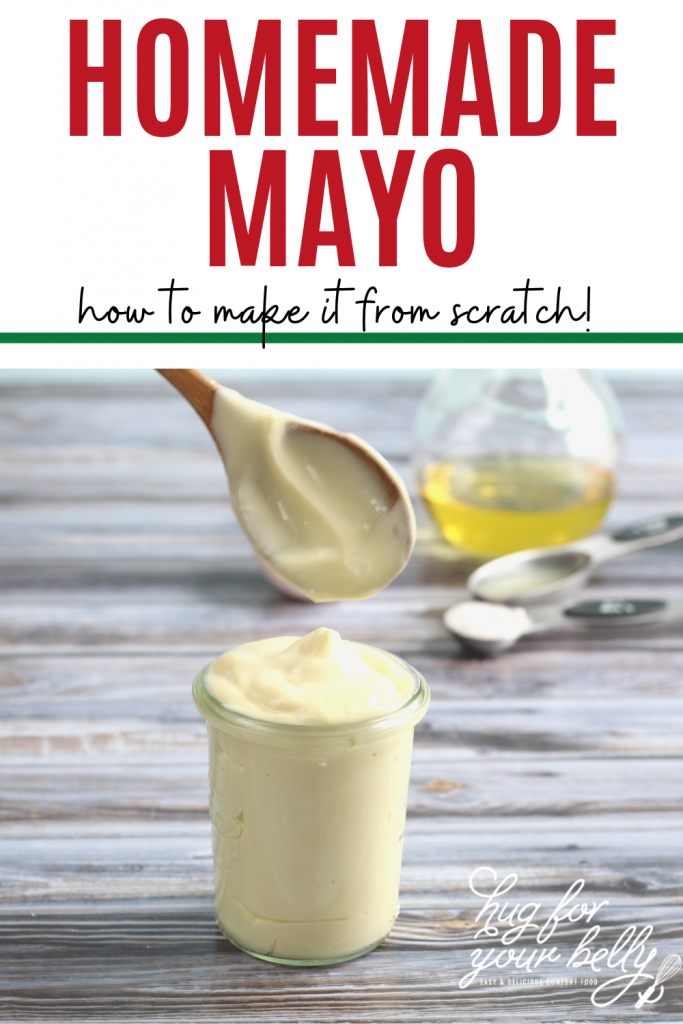 wooden spoon over jar of homemade mayo