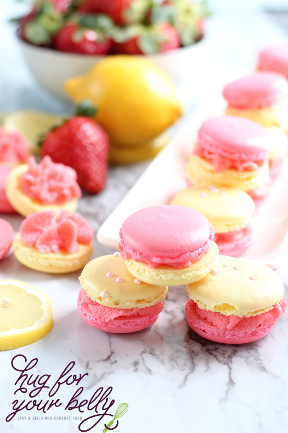 pink and yellow macarons stacked