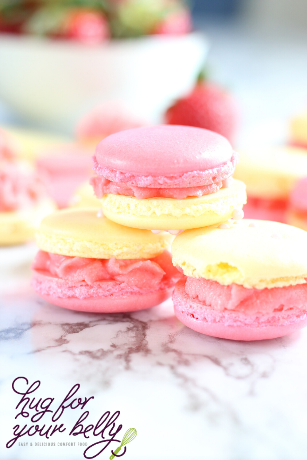 pink and yellow macarons stacked on each other