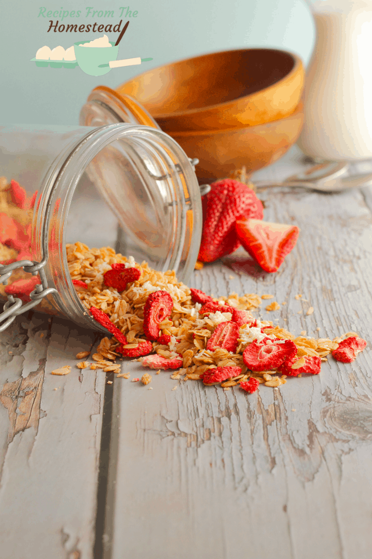 strawberry coconut granola spilling out of jar