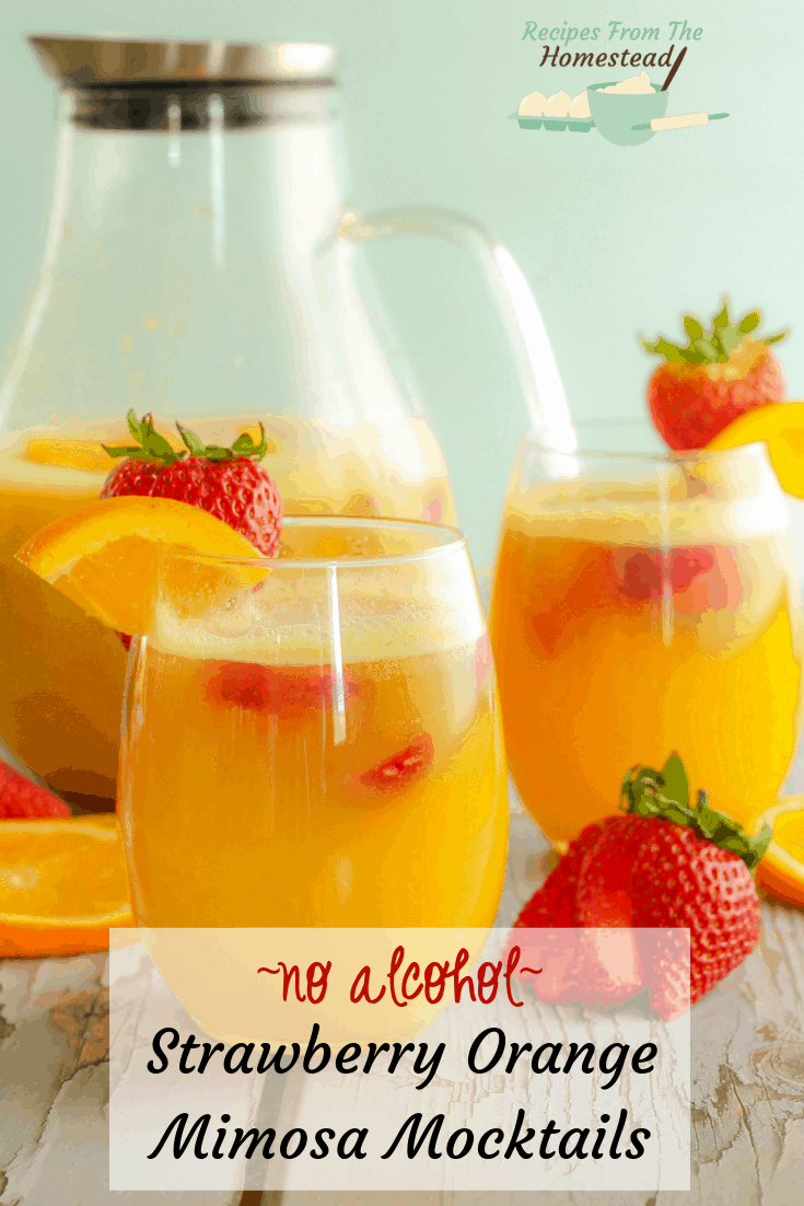 strawberry orange mimosa mocktails in wine glasses next to glass pitcher