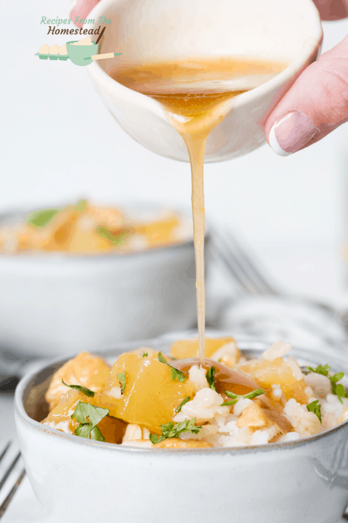 pouring sauce over hawaiian chicken