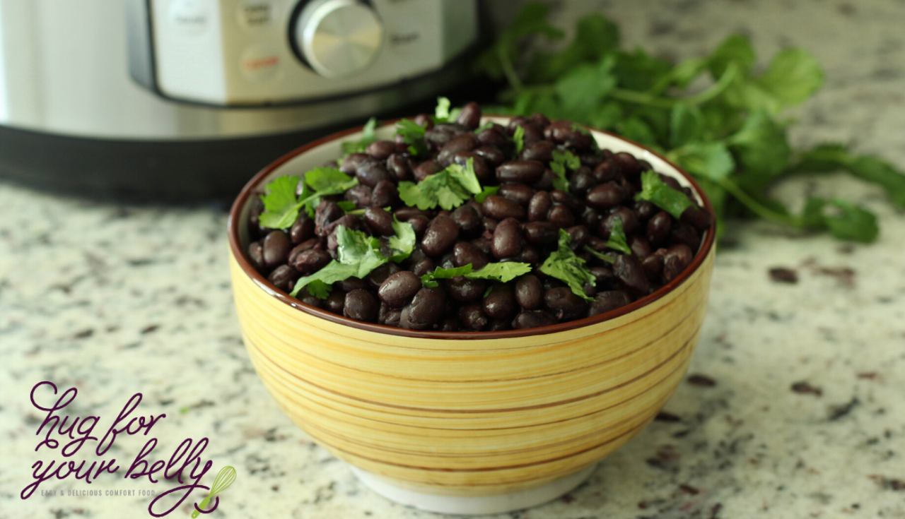 black beans with chopped cilantro on top in yellow bowl