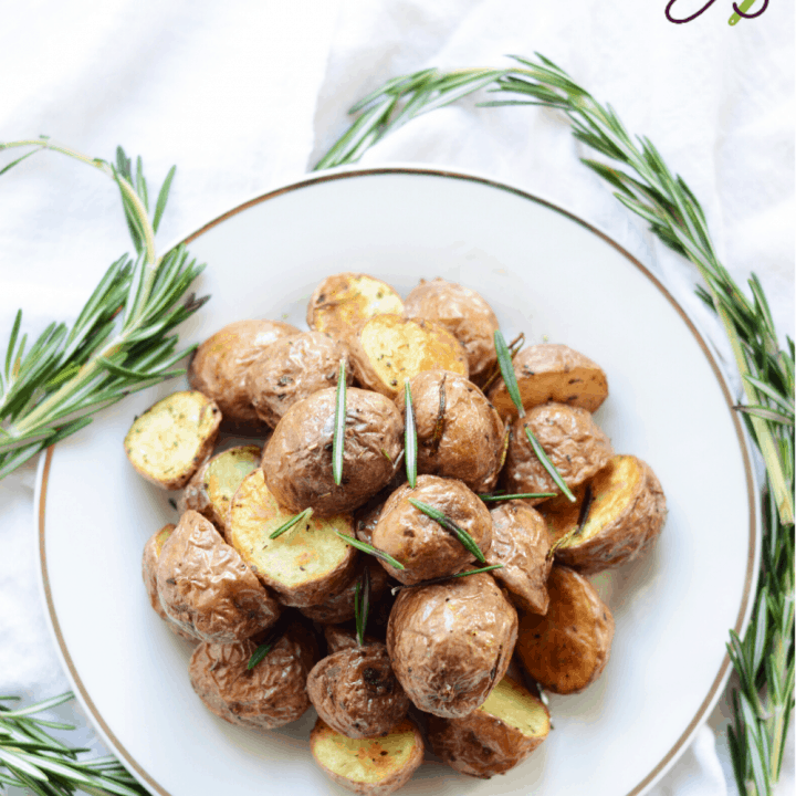 rosemary potatoes on a white plate