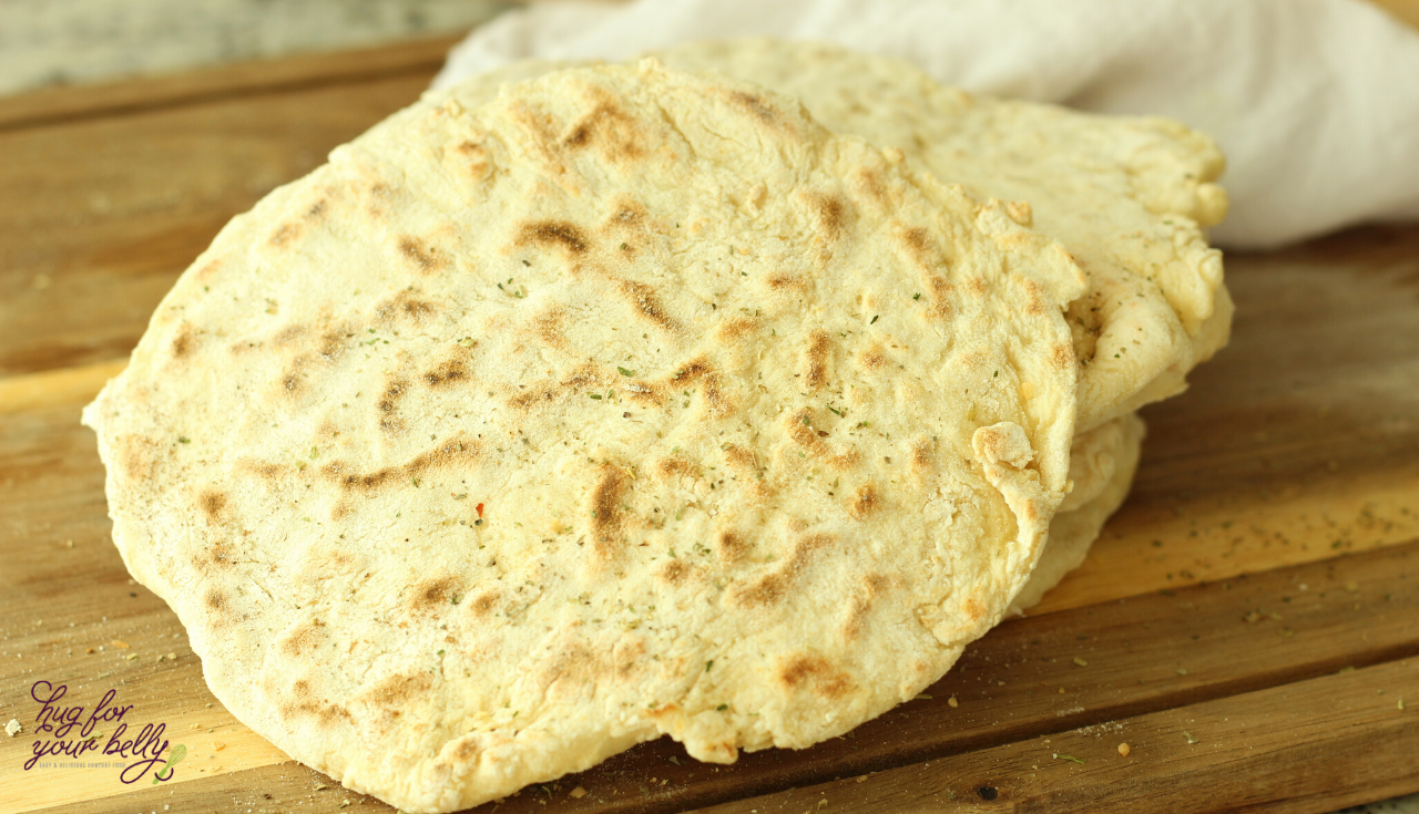 So easy to make, with only 5 basic ingredients that are found in nearly every pantry on a daily basis. You'll love this easy flatbread and all the ways you can use it! #flatbreadrecipes #homemadeflatbread #healthyflatbread #easyflatbread