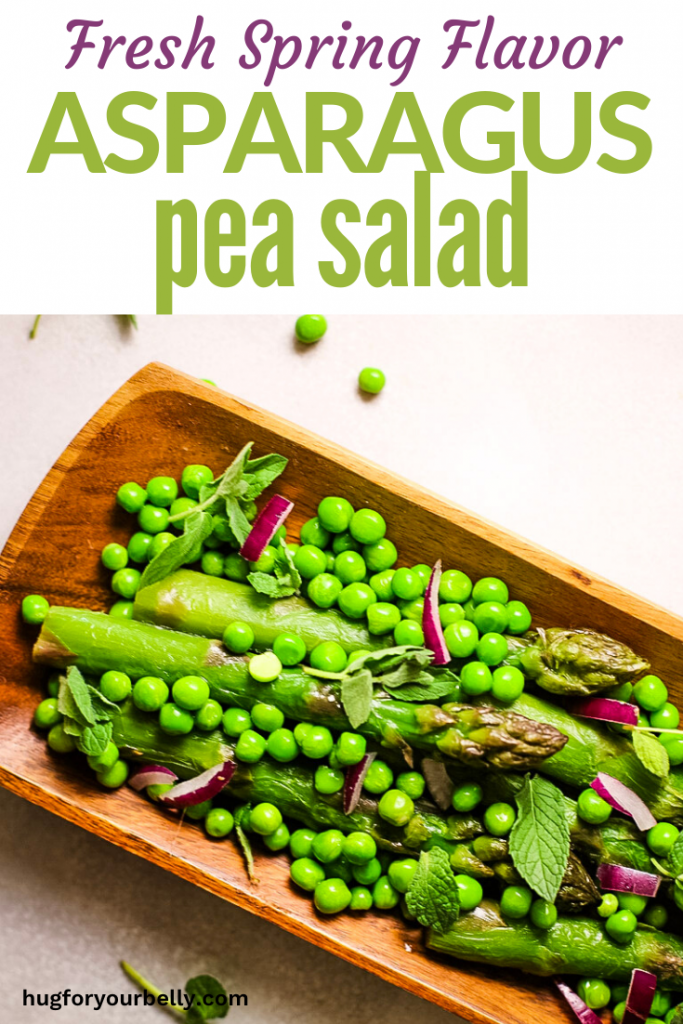 asparagus and peas on wooden plate