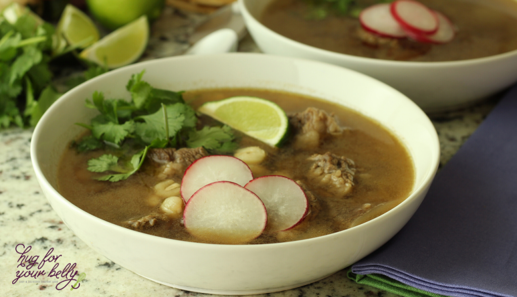 beef posoles in white bowl with radish slices