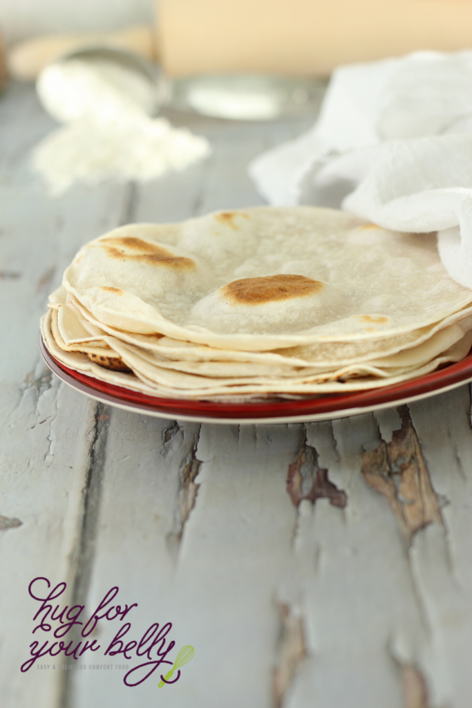 homemade flour tortillas on red plate