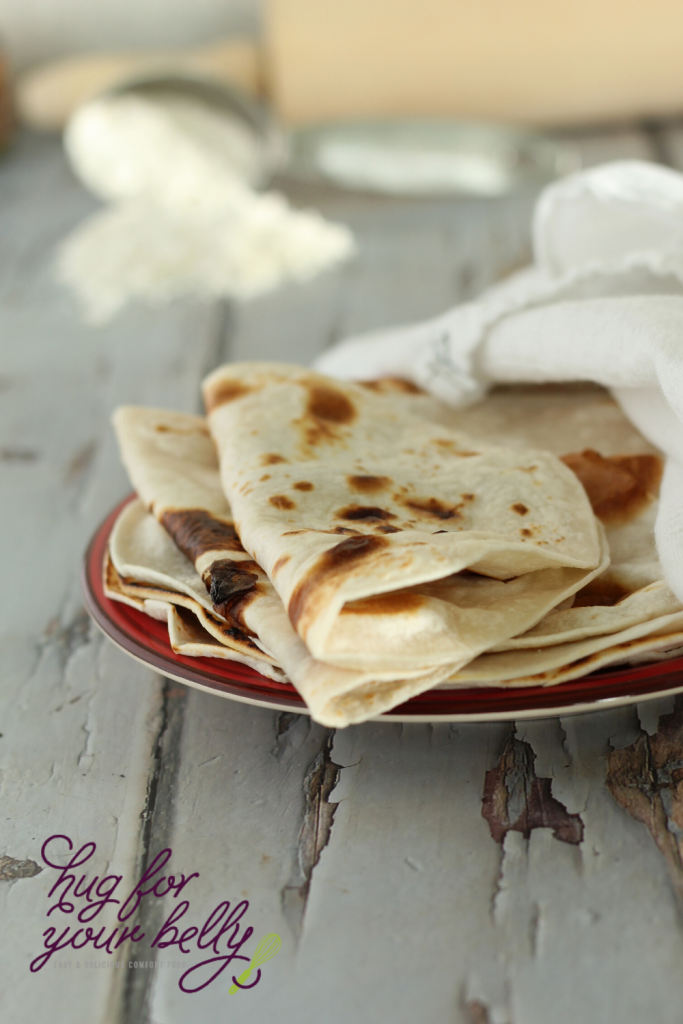 homemade tortillas on red plate