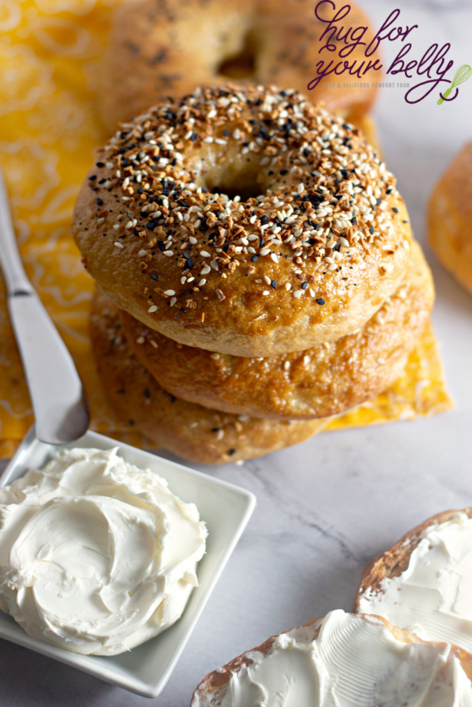 bagels stacked on yellow napkin