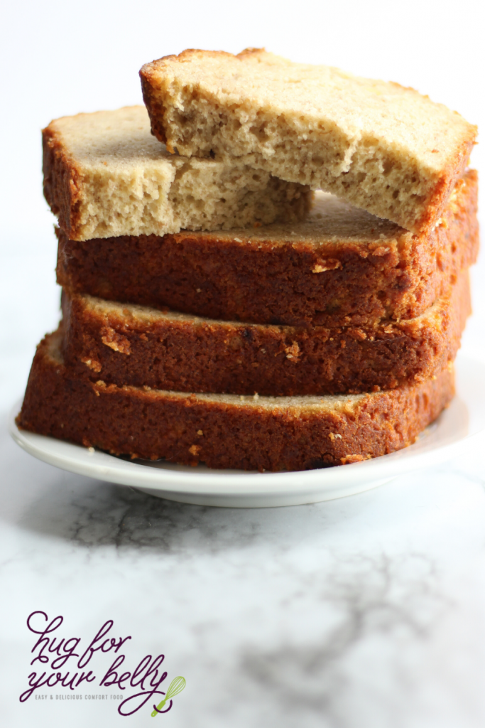 banana bread slices stacked on white plate