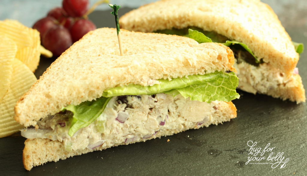 chicken salad sandwich on slate tray