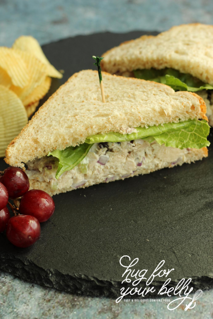 chicken salad sandwich on slate plate