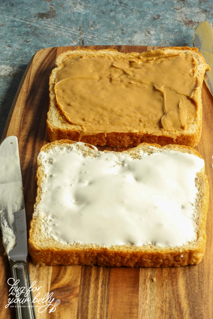slices of bread with peanut butter and marshmallow fluff