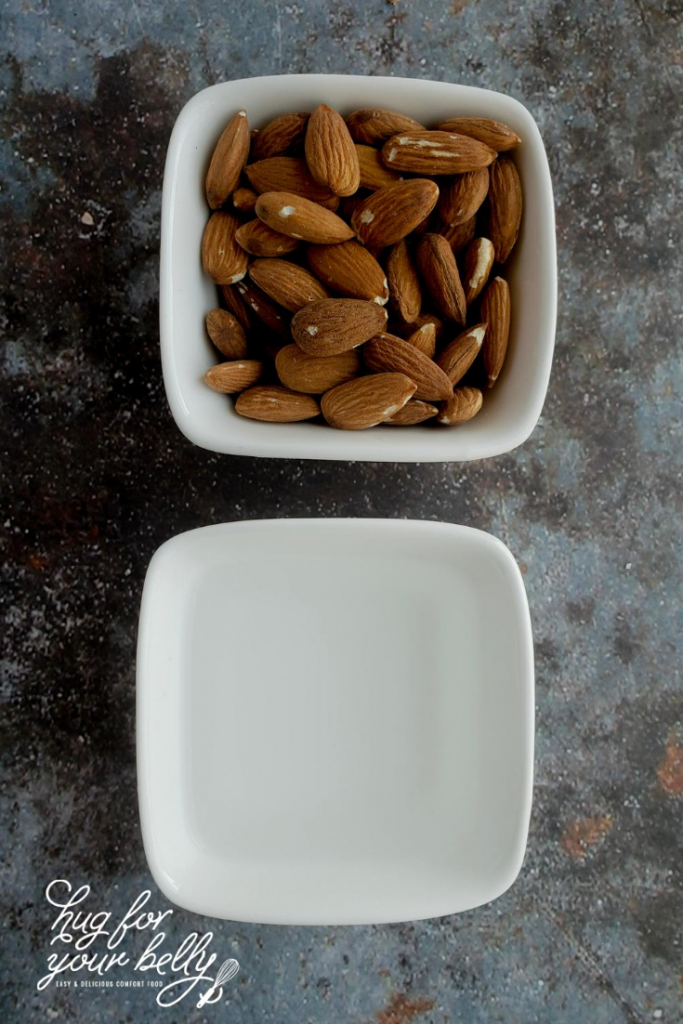 almonds and water in white dishes