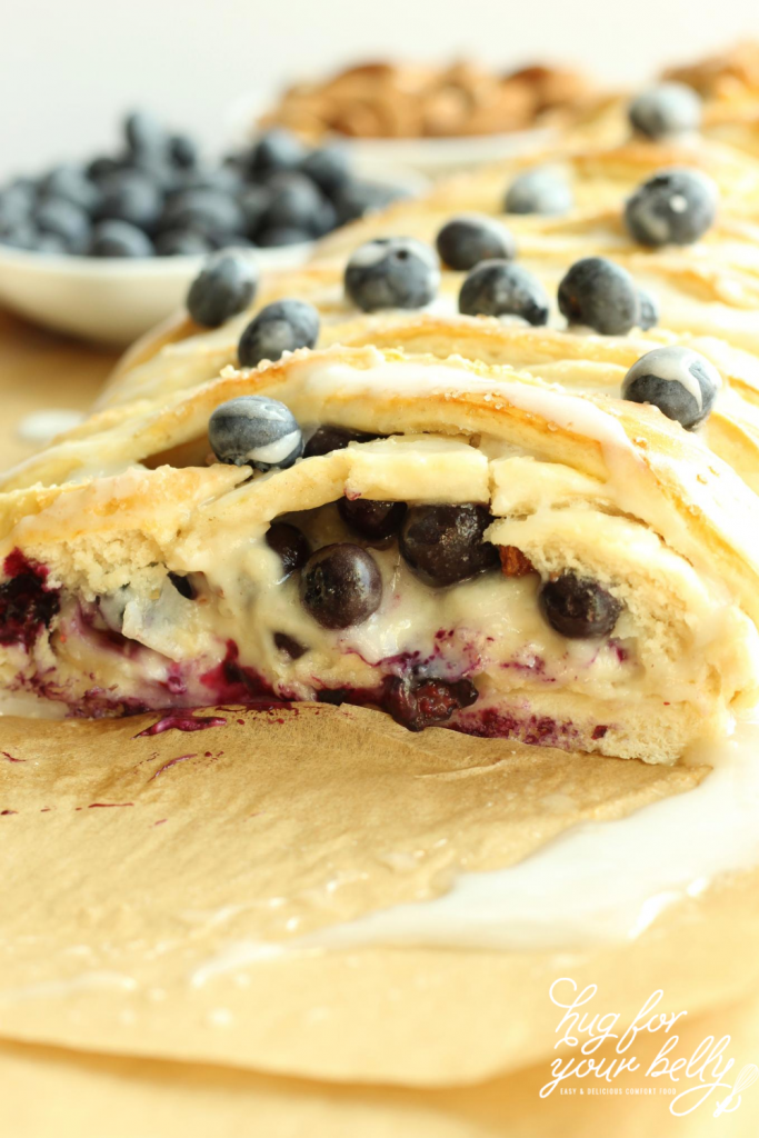 blueberry breakfast braid with slice out of it
