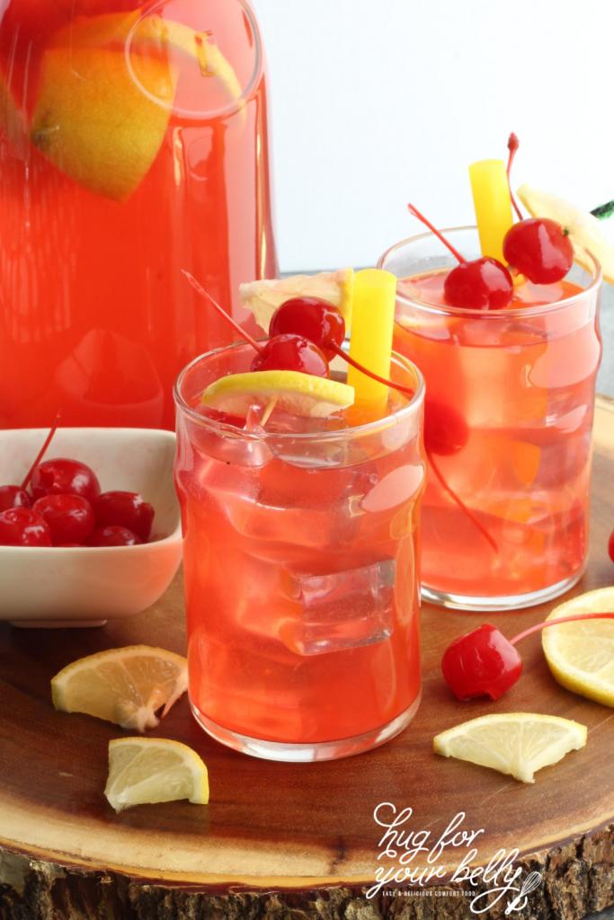 glass of cherry lemonade on wooden background
