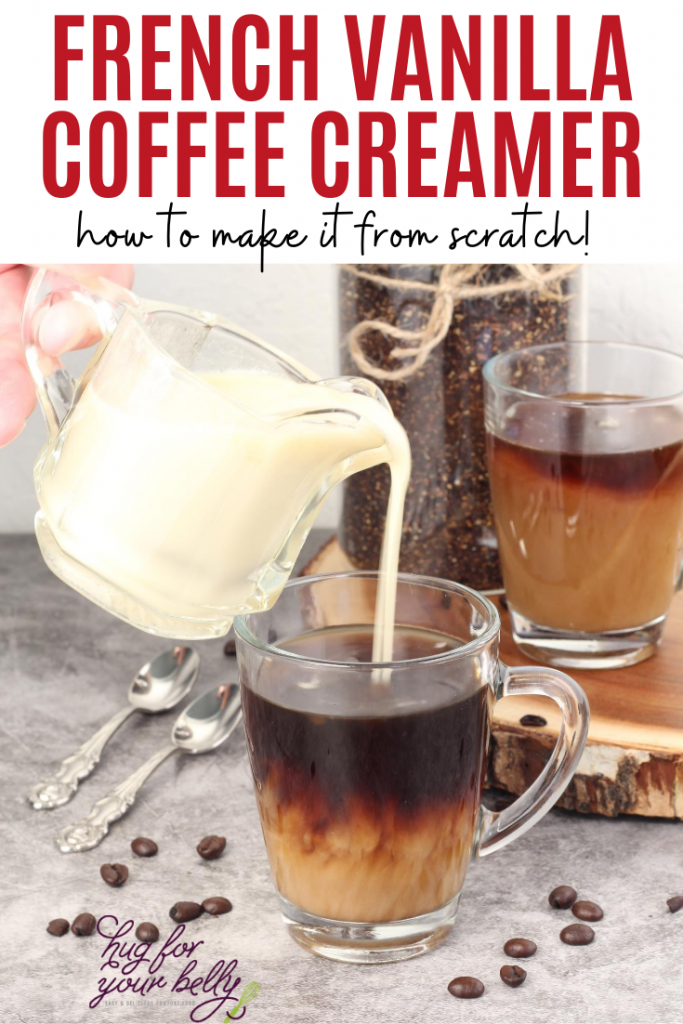 creamer being poured into coffee cup