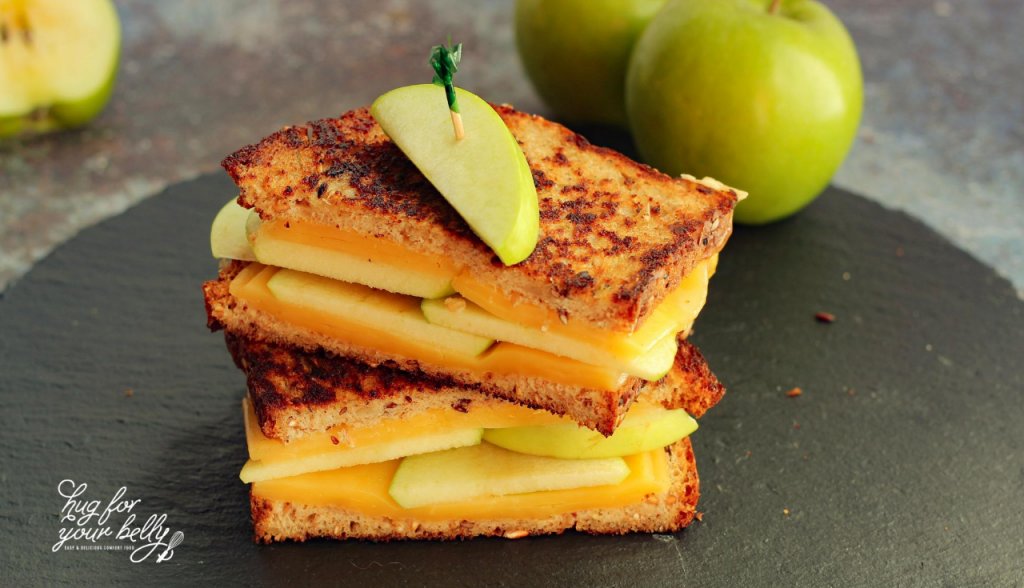apple gouda grilled cheese on black platter