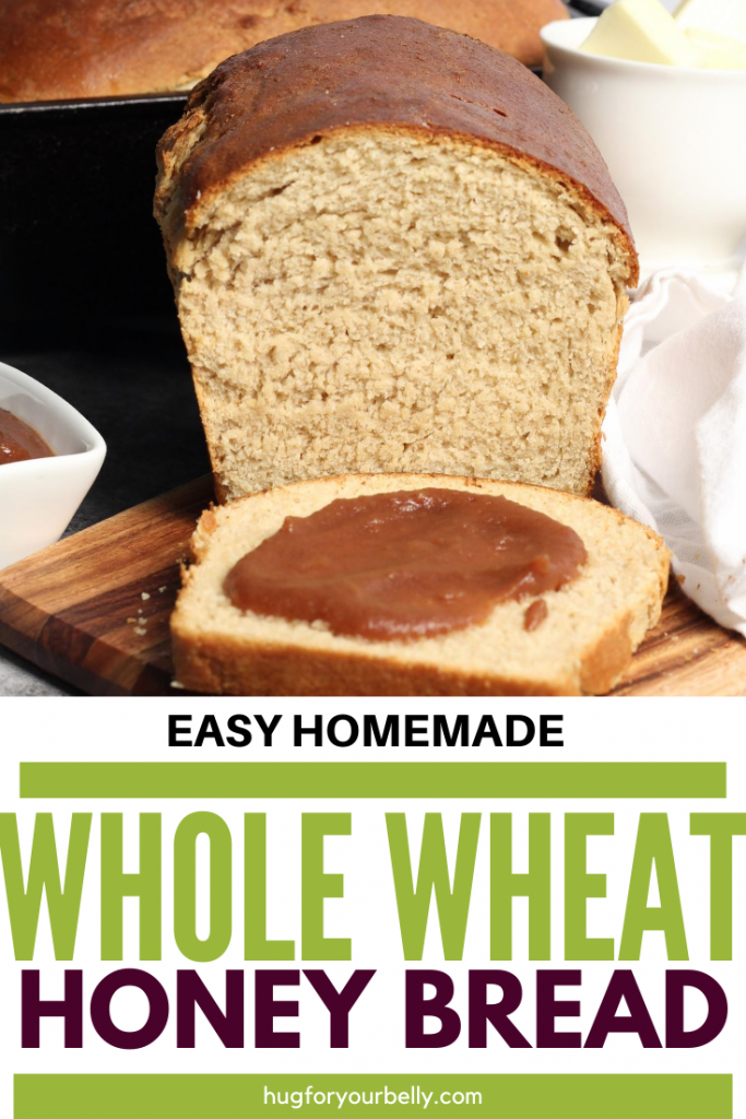 honey wheat bread with peach butter spread on a slice
