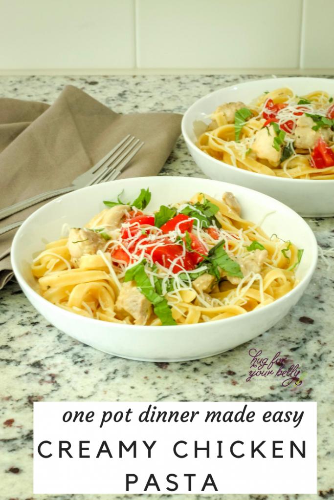 creamy chicken pasta in white bowl