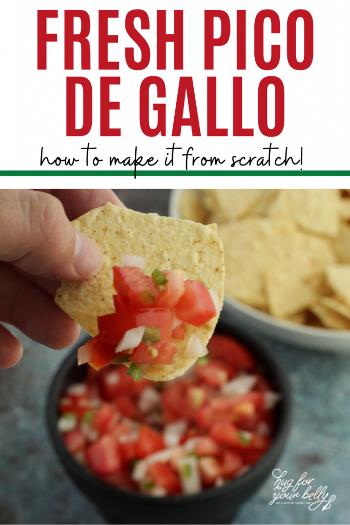 hand holding chip with pico de gallo