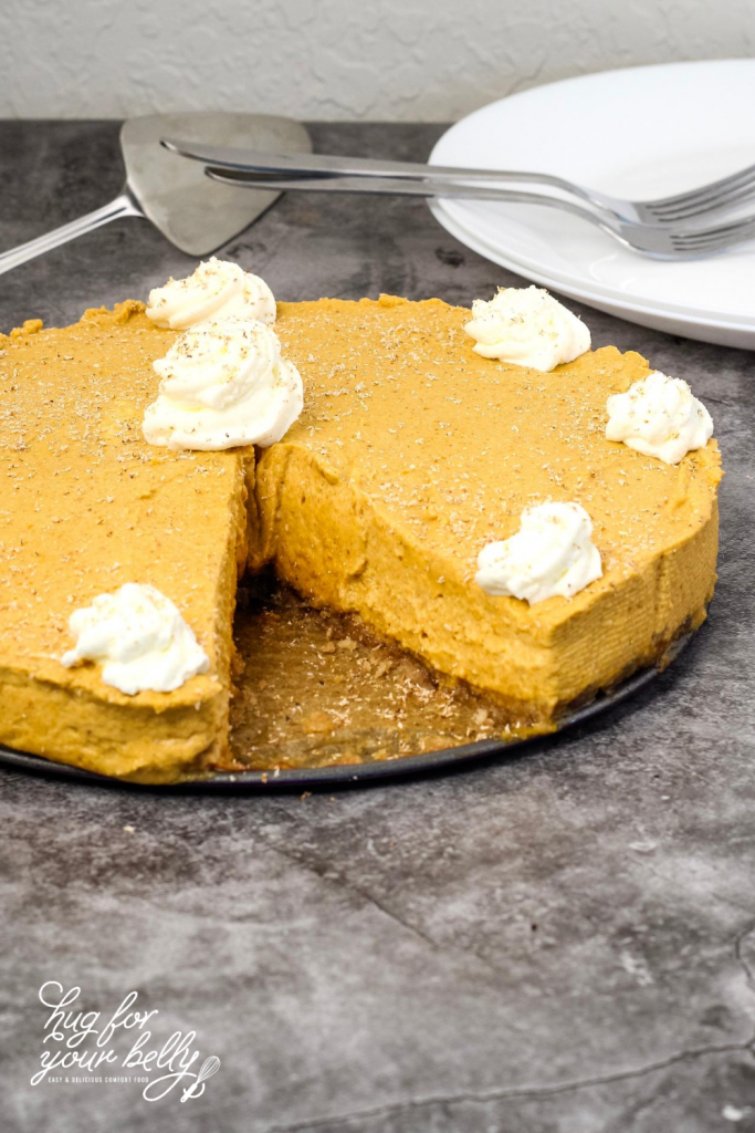 pumpkin cream pie with white plates in background