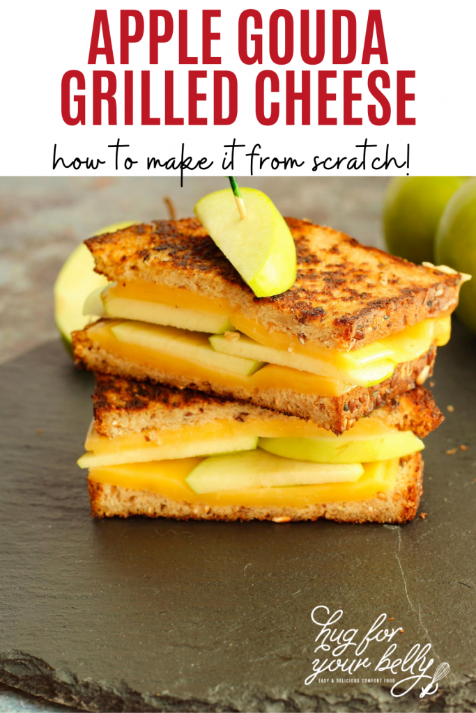 apple grilled cheese on black serving board