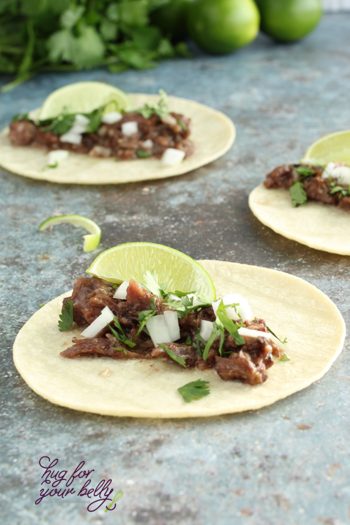 barbacoa tacos on corn tortillas