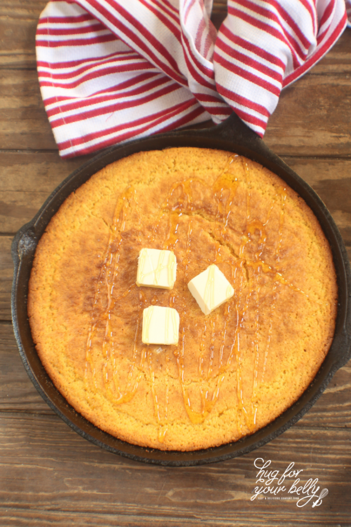 cornbread with butter and honey baked in cast iron skillet