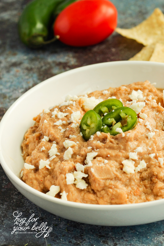 refried beans in white bowl