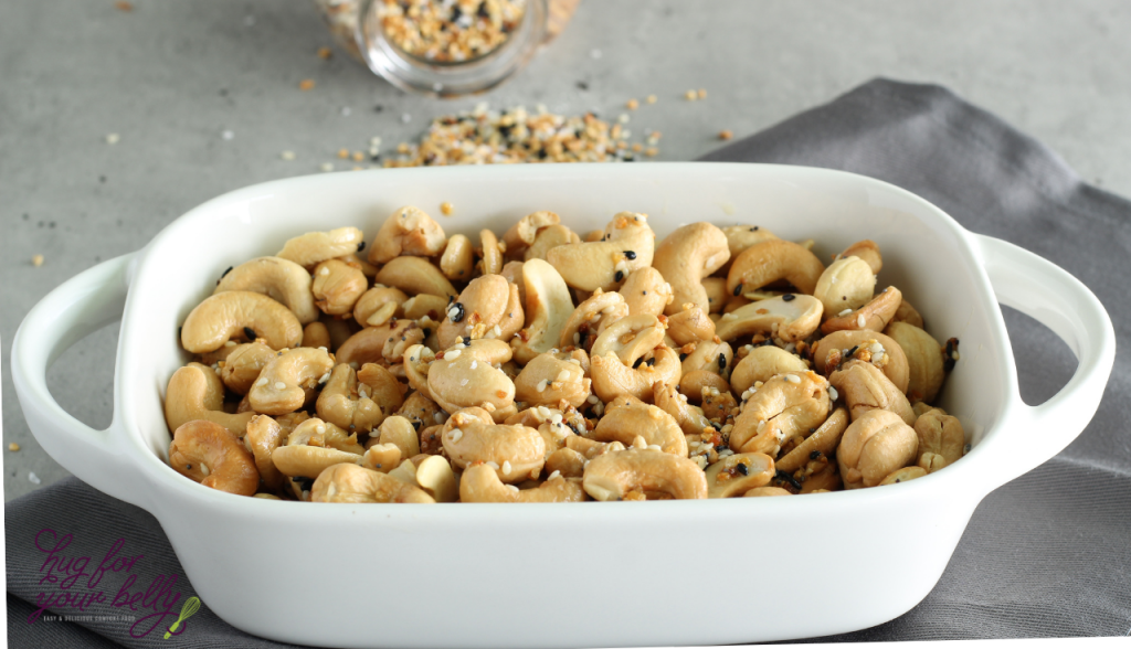 everything bagel cashews in white dishes