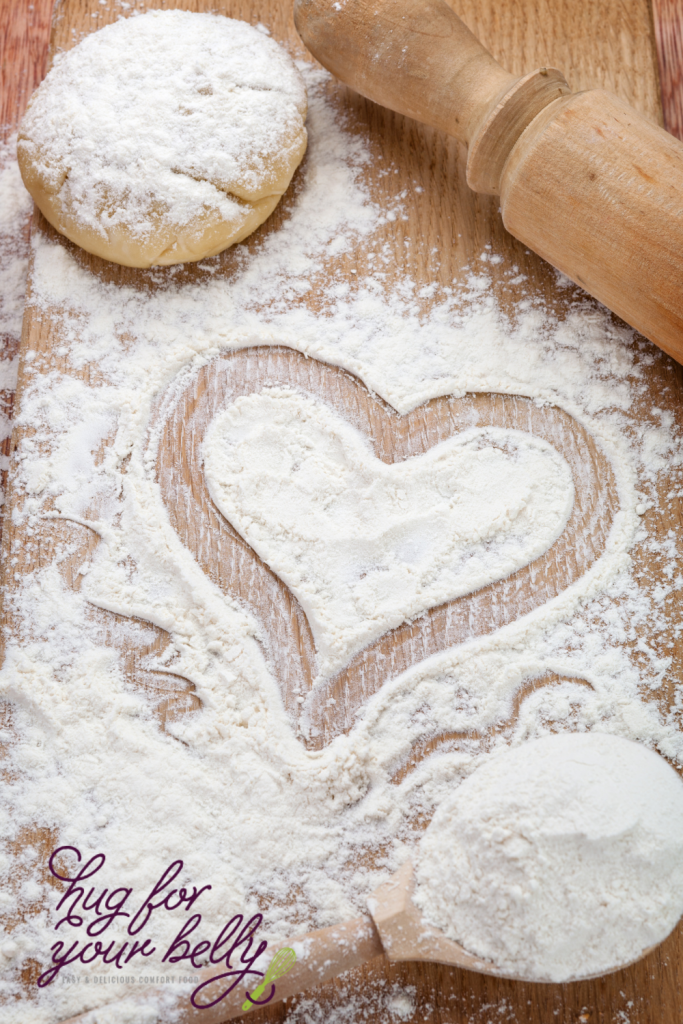 heart drawn into flour on wooden board
