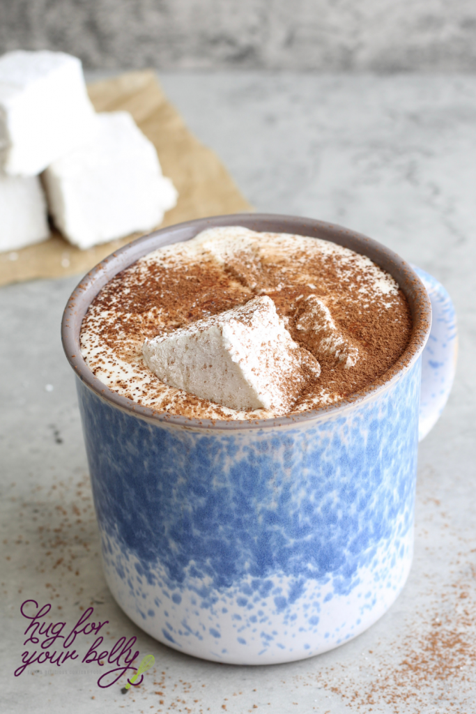 hot chocolate in blue cup with melted marshmallows