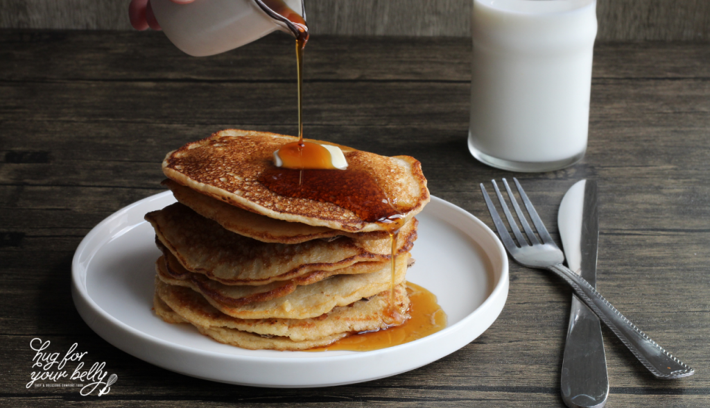 fluffy pancakes on white plate