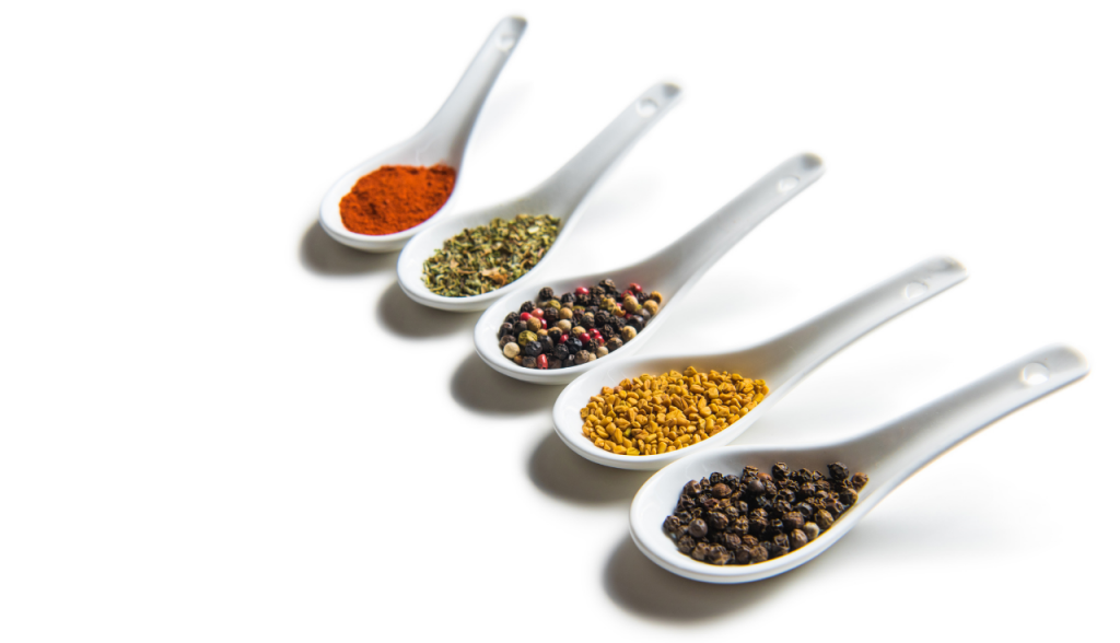 spices on white spoons