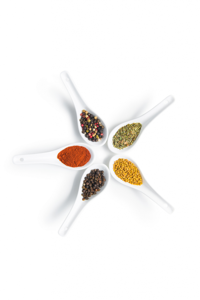 spices in white spoons