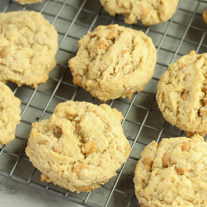 peanut butter chip cookies in a row on a cooling rack