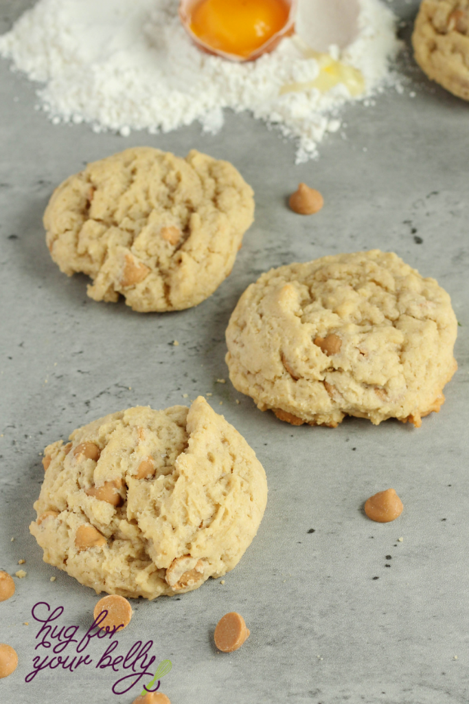 3 peanut butter chip cookies on a marble background