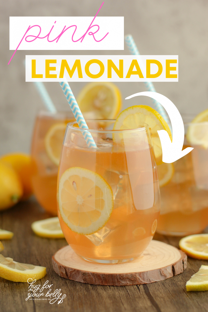 pink lemonade in glasses, with lemon slices, ice cubes and straws