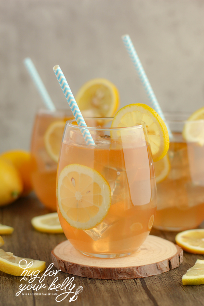 pink lemonade in glass with ice and lemon slices