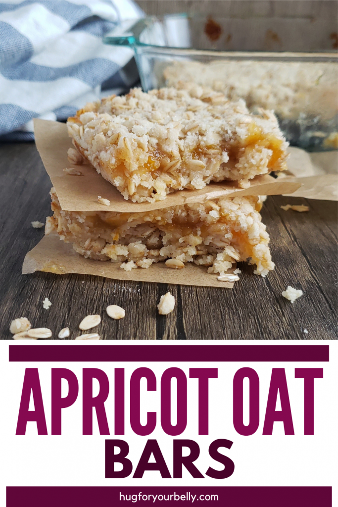 apricot oat bars stacked on wooden background